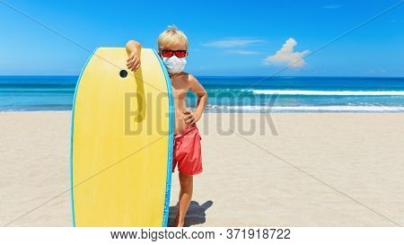 Young Surfer Wearing Sunglasses, Protective Mask On Sea Beach With Body Board. Summer Tours, Cruises