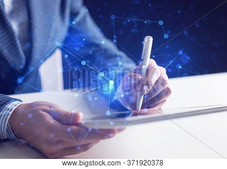 Project Management And Internet Researching Process. Man In Business Suit Using Tablet Computer. Vir