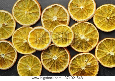 Creative Layout Made Of Sundried Orange Slices. Christmas Composition.