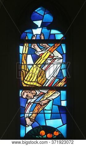 WASSERALFINGEN, GERMANY - MAY 05, 2014: Angel, stained glass window at Evangelical Church in Wasseralfingen, Germany