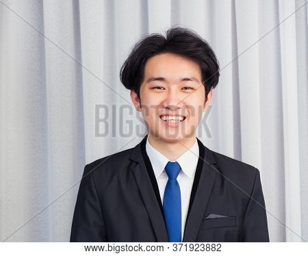 Portrait Closeup Of Happy Asian Young Handsome Manager Professional Business Man Laughing Confident