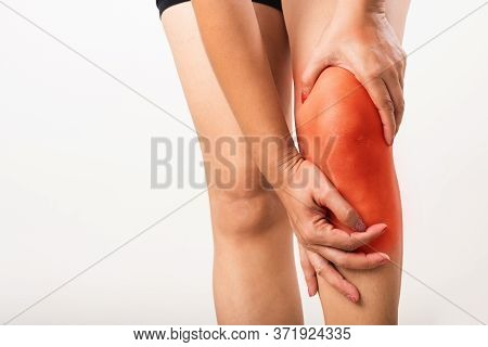 Closeup Young Asian Woman Joint Holding Her Painful Knee, Studio Shot Isolated On White Background,