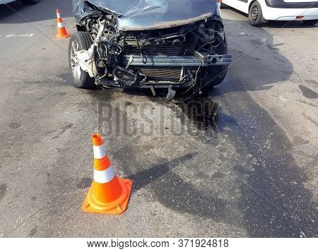 Broken Suv Car After Front Collision Damaged Engine Compartment Of Vehicle Fenced By Orange Traffic