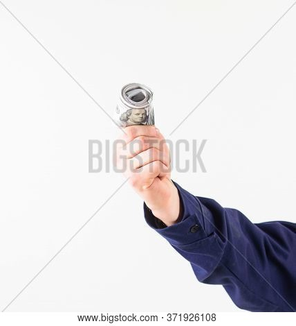 Hand Holds Money, Cash, Dollar Banknotes. Roll Of Money,