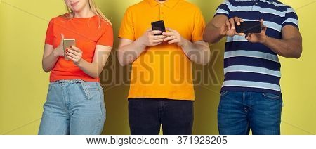 Group Of Friends Using Mobile Smartphones. Teenagers Addiction To New Technology Trends. Close Up. M