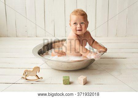 Kids Hygiene. Shampoo, Hair Treatment And Soap For Children. Kid Bathing In Large Tub. Baby Boy Wash