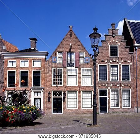Groningen,holland-july 12,2019:typical Dutch Houses With Step Gables In The Sint Walburgstraat, Gron