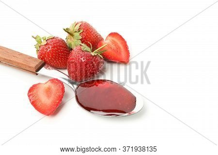 Strawberry And Spoon With Strawberry Jam Isolated On White Background