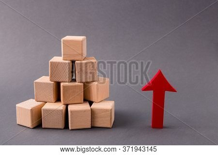 Photo Of Pile Stack Wooden Cubes Market Supply Sales Growing Rising Raising Red Arrow Pointing Up In