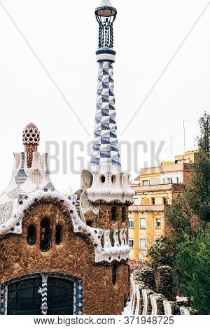 The Central Entrance To The Park Guell In Barcelona. Gingerbread Houses. Right House With A Long Tow