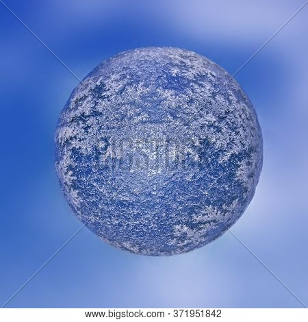 3D rendering of ice-bound mini planet against blue sky