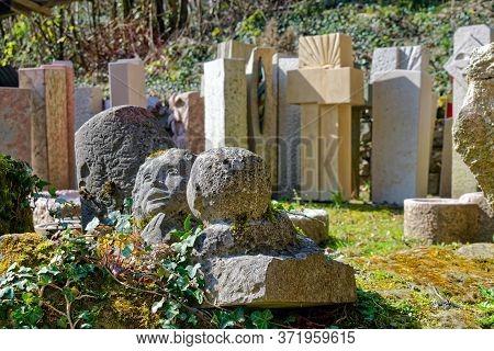 Bern, Switzerland - March 28, 2020: Various Gravestones, Cemetery Sculptures And Memorial Statues Ar