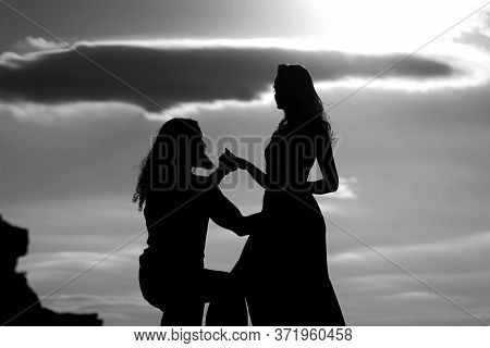 Shadow Figures Of Man And Woman Holding Hands. Love And Relations. Silhouettes Of Love Couple Man An