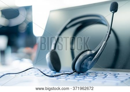 Call Center Operator Desktop. Close-up Of A Headset On A Laptop. Help Desk. Workplace Of A Support S