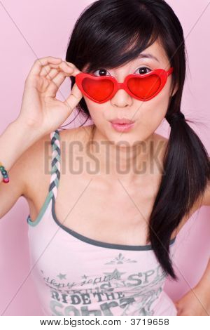 Playful Asian Girl With Heartshaped Sunglasses