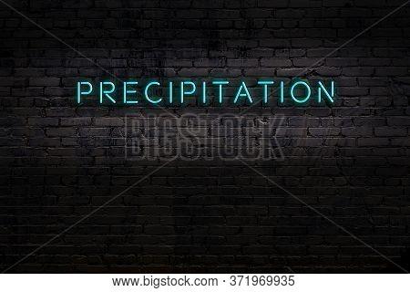Neon Sign On Brick Wall At Night. Inscription Precipitation