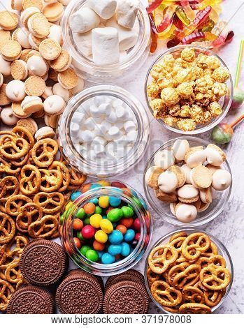 Sweet Food. Topview Of Various Sweets In Bowls And Scattered Over The Table. Sweets Background
