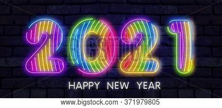 Colorful Neon 2021 Happy New Year Neon Banner. Realistic Bright Neon Billboard On Brick Wall. Concep