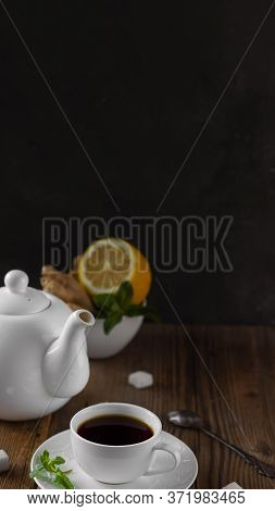 White Ceramic Teapot, Tea Set With Dark Brown Hot Drink, And Natural Healthy Flavours Lemon, Lump Su