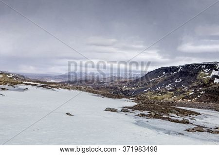 Grey Clouds Hang Over The Winter Landscape In Iceland