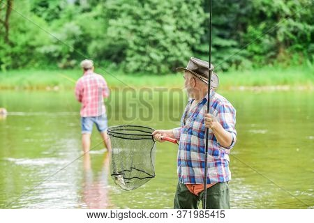 Happy Retirement. Father And Son Fishing. Male Friendship. Family Bonding. Summer Weekend. Two Fishe