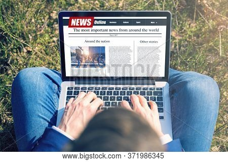 Work Outside Concept. Men Reading News On A Computer Screen. Mockup Website. Newspaper And Portal On
