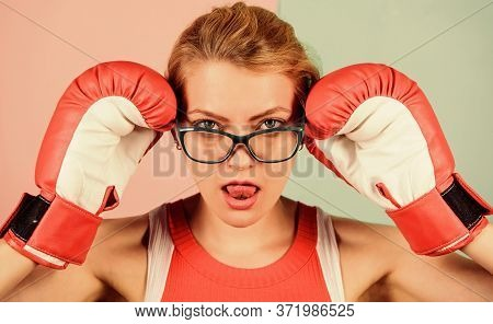 Smart Strong And Sexy. Super Woman Concept. Successful Womanhood. Woman Boxing Gloves Adjust Eyeglas