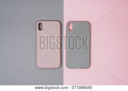 Two Silicone Protective Cases For The Smartphone. Grey And Pink Phone Cases.