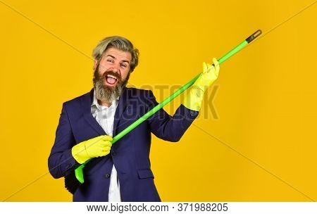 Spring Cleaning. Cleaning Service People. Mature Male Worker With Broom Clean. Male Janitor Cleaning