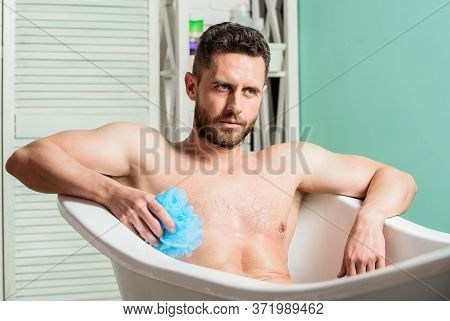 Sex And Relaxation Concept. Wash Off Foam With Water Carefully. Macho Enjoying Bath. Sexy Man In Bat