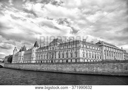 Place Of Interest. Palace At Embankment. Palace Building River View. Old Palace In Paris France. Pal