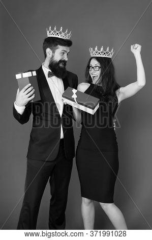 Reward Celebration. Happy Couple Celebrate Success. Sexy Woman And Bearded Man Wear Crowns. Best Emp
