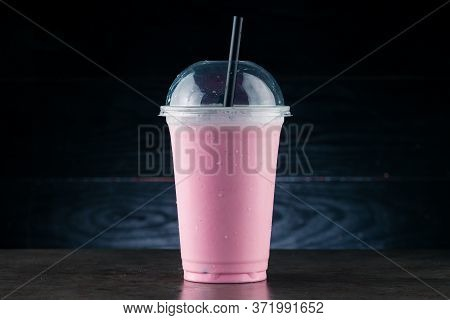 Diet Food And Healthy Nutrition. Pink Fruit Smoothie, Cherry Milkshake In Plastic Glass On A Dark Ba