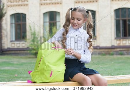 Doing Homework Outdoors. Small Child Do Homework. Little Girl Open School Bag. Homework Assignment.