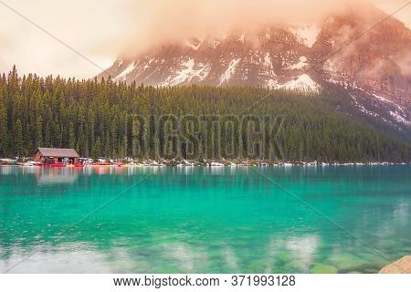 Vibrant Clouds Over A Tranquil Lake Louise