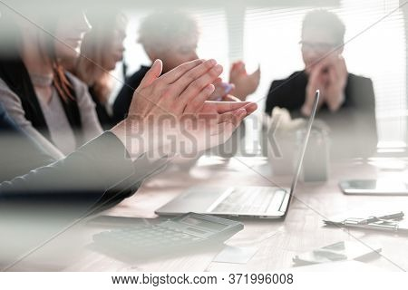 Business people clapping and applause at meeting or conference, close-up of hands.