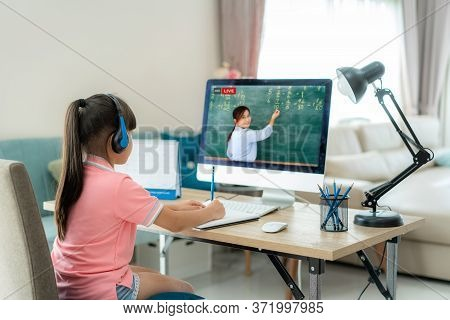 Asian  Student Girl Video Conference E-learning With Teacher On Computer In Living Room At Home. E-l
