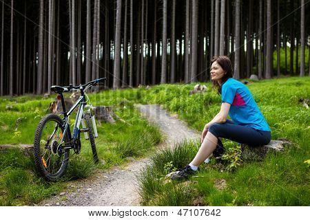Woman resting after riding bike