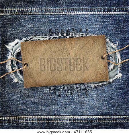 Background Denim Texture With Cardboard Label