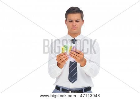 Businessman counting money on white background