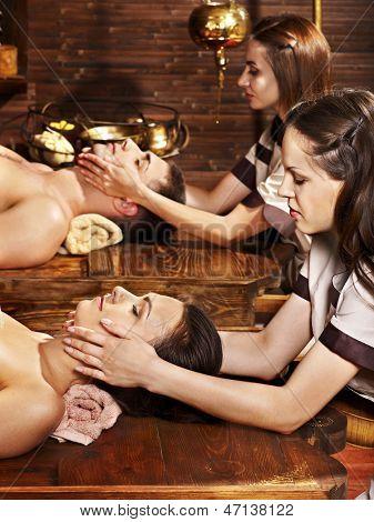 Couple  having oil Ayurveda spa treatment. poster