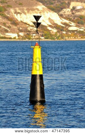 Black and yellow buoy on the Black Sea