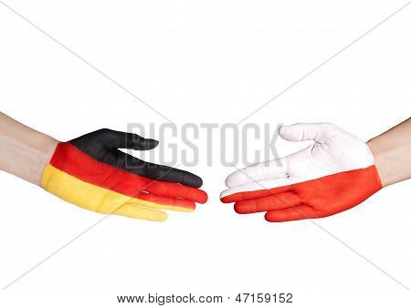 Hands With German And Polish Flag
