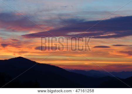 Dramatic Sunrise Over Mountains