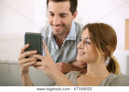 Young people at home using smartphone