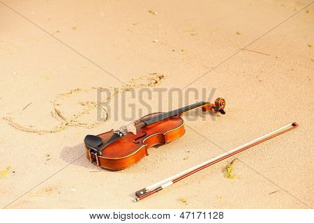 Violin And G Clef On Beach. Music Concept