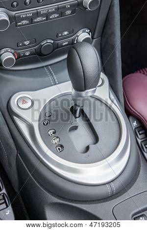 automatic gear shifter in black dashboard inside sports luxury car