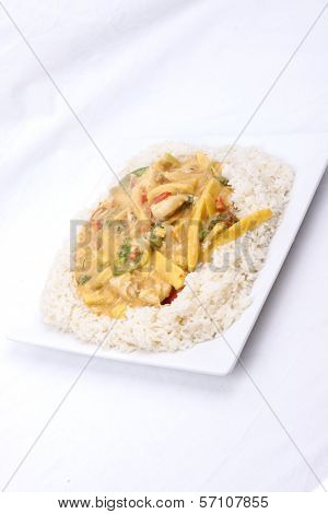 diced chicken in coconut curry sauce served with rice poster