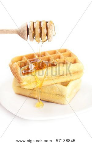 Belgian Waffles On A Plate, Stick For Honey And Honey Isolated On White