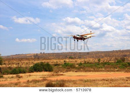small aricraft on savanna landscape